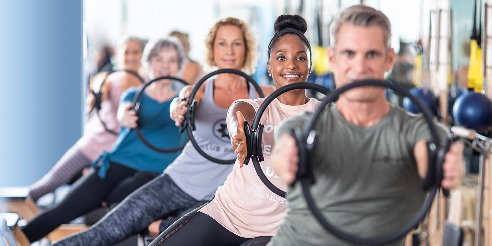 Group exercising in a Club Pilates class