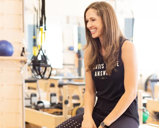 Club Pilates instructor smiling